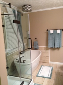 We added a frameless glass shower and a freestanding tub.